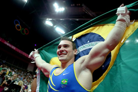 LONDON, ENGLAND - AUGUST 06:  Arthur Nabarrete Zanetti of Brazil reacts after winning the gold medal on the Artistic Gymnastics Men's Rings on Day 10 of the London 2012 Olympic Games at North Greenwich Arena on August 6, 2012 in London, England.  (Photo by Ronald Martinez/Getty Images)