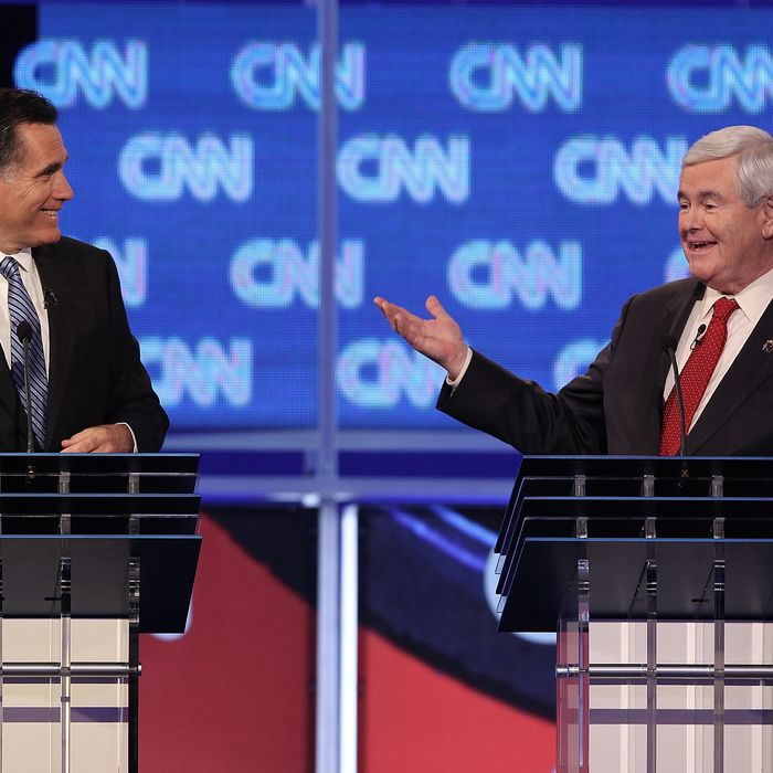 Republican presidential candidate former Speaker of the House Newt Gingrich (R), next to former Massachusetts Gov. Mitt Romney, makes a point during a debate at the North Charleston Coliseum January 19, 2012 in Charleston, South Carolina. The debate, hosted by CNN and the Southern Republican Leadership Conference, is the final debate before South Carolina voters head to the polls for their primary January 21.