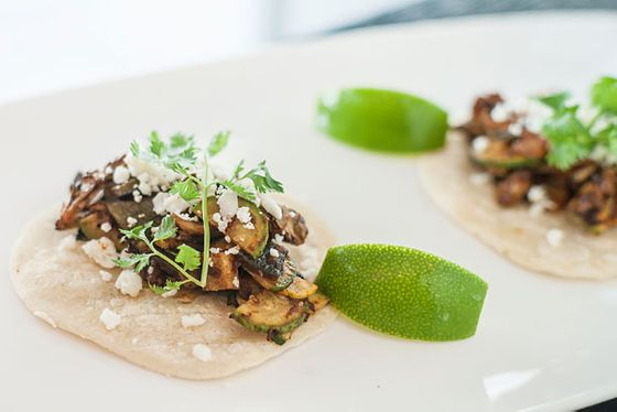 "<b>What to Order:</b> Grilled Vegetable Taco (pictured)      <i>104 North End Ave., nr. Vesey St.; 646-747-1600</i>; (<a href=""http://nymag.com/listings/restaurant/north-end-grill/"">See the Listing</a>)        Floyd Cardoz is a <i>Top Chef Masters</i>–winning chef who went from making inspired Indian fine dining at Tabla to thoughtful takes on American tavern food at North End Grill. Lost in all that is the fact that he's also the driving force behind Union Square Hospitality's <a href=""http://unionsquareevents.com/index.php/sports/view/el-verano-taqueria"">El Verano Taqueria stands</a>. It's a lot to keep track of, but Cardoz helpfully distills the best from all of his endeavors into the new bar-only tacos served at North End Grill. We say amp up the eclecticism further and wash them down with the Scotch-based Stone Fence cocktail."