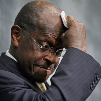 Republican presidential candidate and former CEO of Godfather's Pizza Herman Cain wipes his brow while participating in a discussion with members of the Congressional Health Care Caucus on Capitol Hill November 2, 2011 in Washington, DC. Part of the