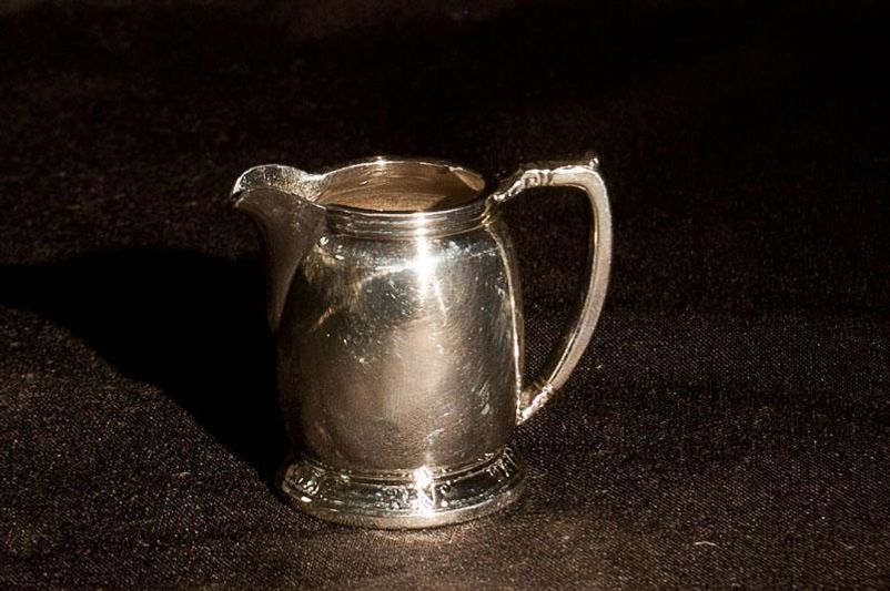 "The sender of this 1948 silver creamer signed the package simply ""Jane Doe."""