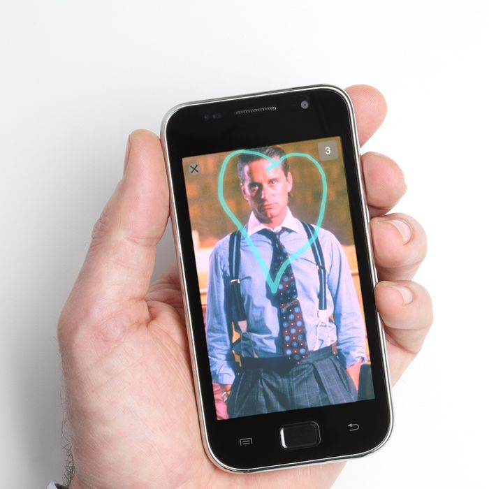 Italy --- Male hand holding a smart phone --- Image by ? Ocean/Corbis