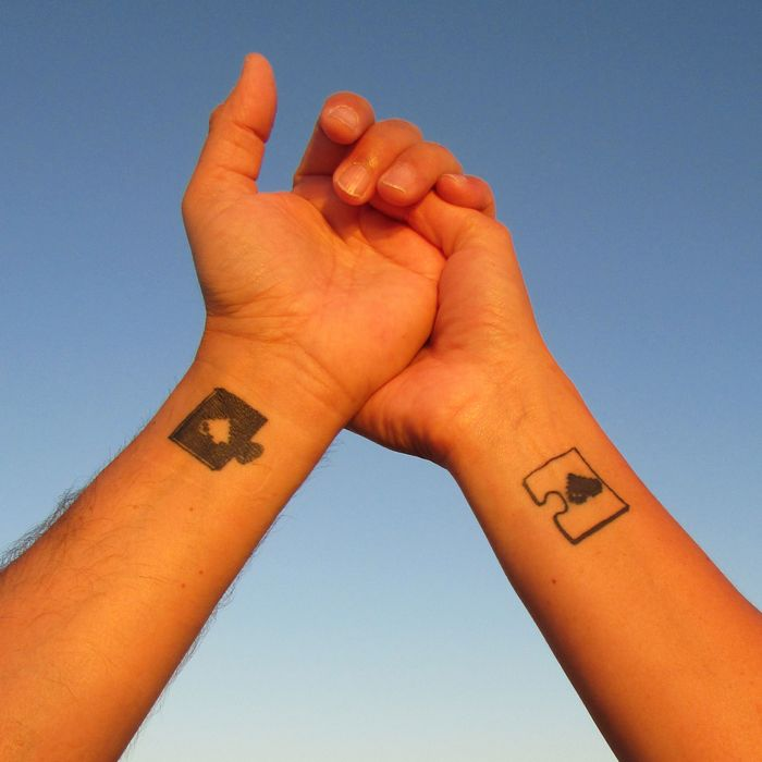 A couple with matching puzzle piece tattoos.