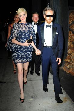 Anne Hathaway and Adam Shulman with James Corden (behind) attend the 'PUNK: Chaos To Couture' Costume Institute Gala after party at The Standard hotel on May 6, 2013 in New York City.