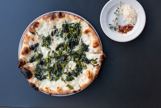 "<b><a href=""http://pizzeriadelfina.com/"">Pizzeria Delfina</a></b>    <i>3611 18th Street & 2406 California Street at Fillmore, SF</i>         As with sister restaurant Delfina next door, and with Tartine Bakery on the corner, it's hard to recall a time when the block of 18th Street between Guerrero and Dolores was not home to Pizzeria Delfina. But it's only been eight years, since 2005, that Craig and Annie Stoll opened their Neapolitan-ish pizzeria in the Mission, and then expanded a couple years later to Pacific Heights (look for them soon in Burlingame). People flock here for a warm experience, well crafted and flavorful small plates, and consistently delicious pizzas, in particular the simple Napoletana, a red pie with anchovies, capers, hot peppers, olives, and oregano; the cherrystone clam pie with hot peppers, tomato, oregano, and pecorino; and the broccoli rabe with caciocavallo cheese, mozzarella, olives, and hot peppers. And just a tip: They do an <a href=""http://sanfrancisco.grubstreet.com/2012/09/best-off-menu-dish-slideshow.html#photo=13x00011"">off-menu meatball calzone</a> at the California Street location that's become kind of an open secret."