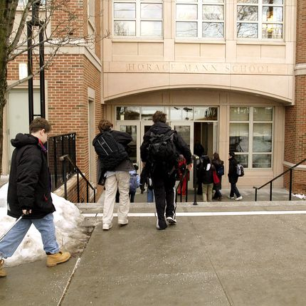 Students arrive at the Horace Mann School on February 4, 2004 in the Riverdale section of the Bronx, New York.  Photographer:  Graham Morrison/ Bloomberg News.