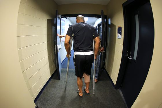 Mariano Rivera #42 of the New York Yankees walks backs into the team's clubhouse after a press conference at Kauffman Stadium May 4, 2012 in Kansas City, Missouri. Rivera tore an ACL while shagging balls during batting practice before a game against the Kansas City Royals on Thursday.