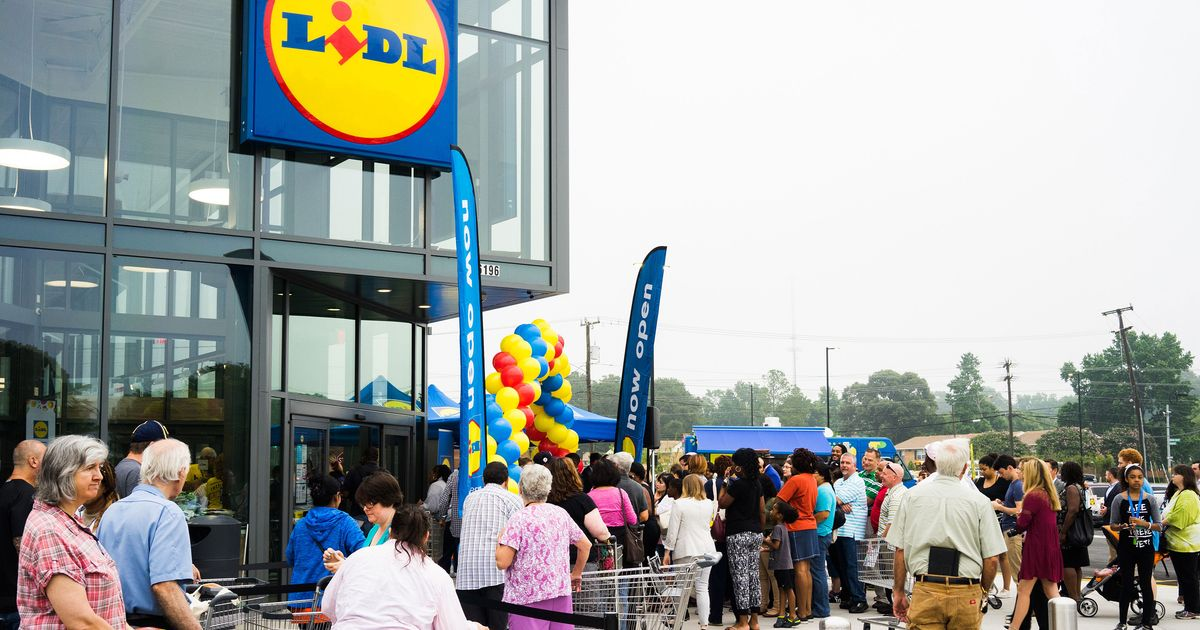 when a new lidl opens customers form iphone length lines. Black Bedroom Furniture Sets. Home Design Ideas