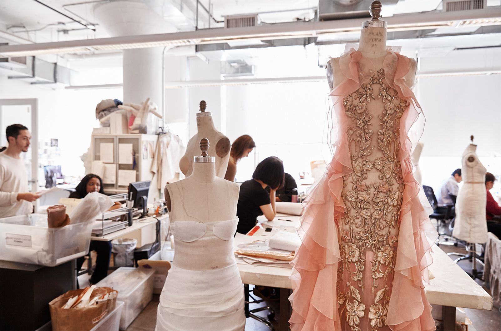 Marchesa dresses on doll forms in various states of completion