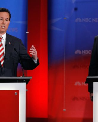 Republican presidential candidate, former U.S. Sen. Rick Santorum (L) makes a point during the NBC News, National Journal, Tampa Bay Times debate held at the University of South Florida on January 23, 2012 in Tampa, Florida.