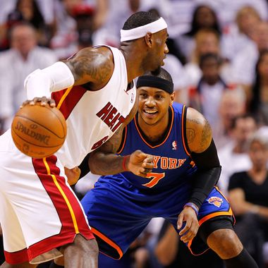LeBron James #6 of the Miami Heat posts up Carmelo Anthony #7 of the New York Knicks during Game Two of the Eastern Conference Quarterfinals in the 2012 NBA Playoffs  at American Airlines Arena on April 30, 2012 in Miami, Florida.