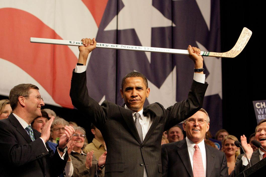 Democratic presidential hopeful, Sen. Barack Obama D-Ill., center, holds a University of North Dakota autographed hockey stick with Sen. Kent Conrad, D-N.D. left, Sen. Byron Dorgan,  D-N.D. and Rep. Earl Pomeroy  D-N.D., right, before he speaks at the North Dakota Democratic Convention in Grand Forks, N.D., Friday, April 4, 2008.(AP Photo/Alex Brandon)