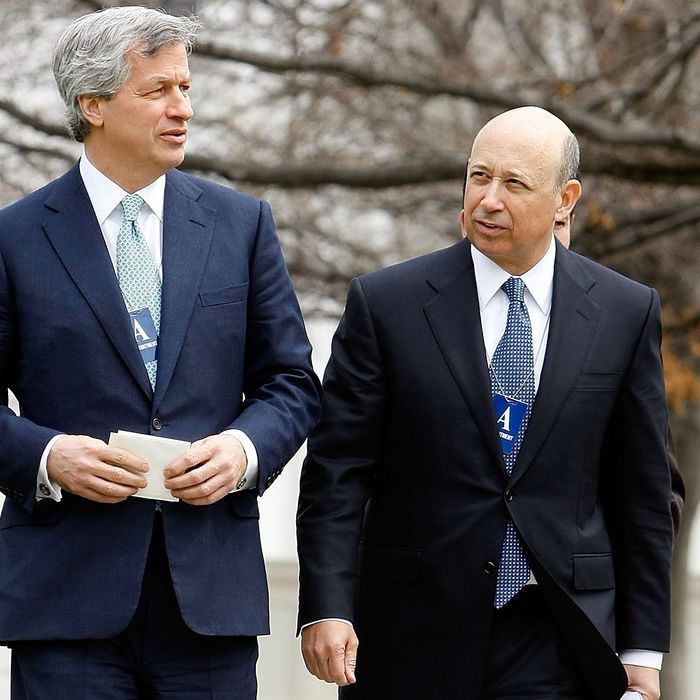 JP Morgan Chase CEO Jamie Dimon (L) and Goldman Sachs CEO Lloyd Blankfein leave the White House after they and 13 other bank heads met with President Barack Obama March 27, 2009 in Washington, DC.