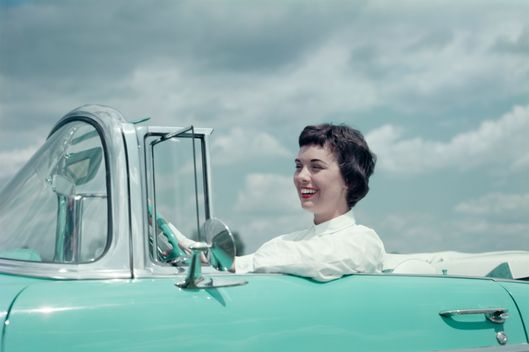 03 Mar 1956 --- Woman driving 1956 Chevrolet Bel Air Convertible.
