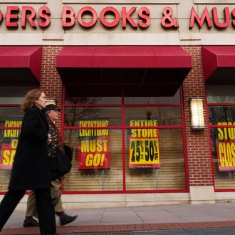 Pedestrians pass by a Borders book store with signs announcing that it will be cloing its doors, March 4, 2001 in Washington, DC. Borders, the second-largest US bookstore chain, filed for bankruptcy on February, 16, the latest blow to an industry hard hit by competition from electronic readers and online booksellers. It planned to close around 30 percent of its over 640 stores in the US. AFP PHOTO/Mandel NGAN (Photo credit should read MANDEL NGAN/AFP/Getty Images)