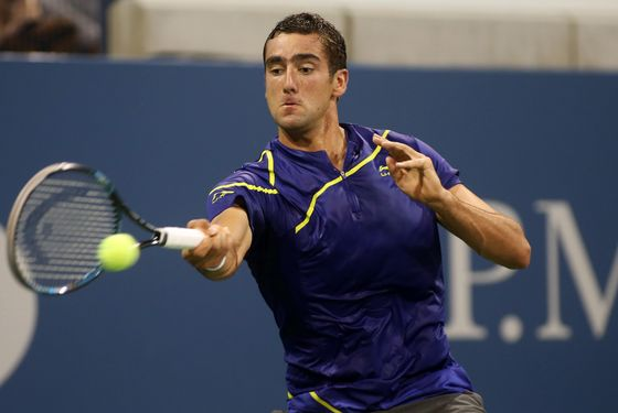 NEW YORK, NY - AUGUST 27:  Marin Cilic of Croatia returns a shot during his men's singles first round match against Marinko Matosevic of Australia on Day One of the 2012 US Open at USTA Billie Jean King National Tennis Center on August 27, 2012 in the Flushing neigborhood of the Queens borough of New York City.  (Photo by Alex Trautwig/Getty Images)