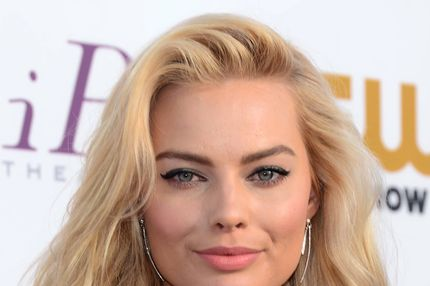 Actress Margot Robbie poses during red carpet arrivals for the Critic's Choice Awards in Santa Monica, California on January 16, 2014.