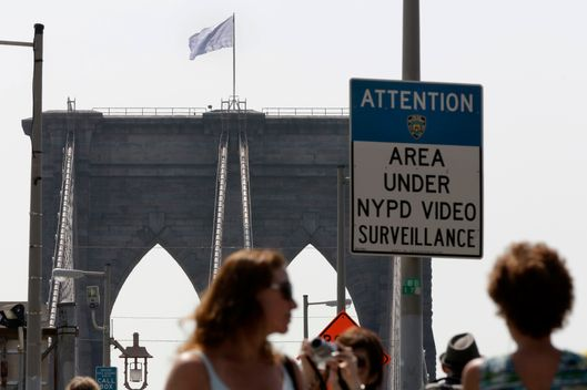 A white flag flies atop the west tower of New York's Brooklyn Bridge, Tuesday, July 22, 2014. Two large American flags atop the Brooklyn Bridge were replaced sometime during the night with white banners. Police crime scene and intelligence detectives were investigating how the flags were switched out on the famed span that connects Brooklyn and Manhattan, and there were no reports of suspicious activity, police said. (AP Photo/Richard Drew)