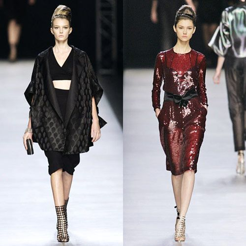 "Inspired by Japanese modernism, Pilati said he was in the mood for ""extreme simplicity"" for spring 2009. He added zing to the easy belted shapes with strips of midriff.   <a href=""http://nymag.com/fashion/fashionshows/2009/spring/main/europe/womenrunway/yvessaintlaurent/"">See the Complete Spring 2009 YSL Collection</a>"