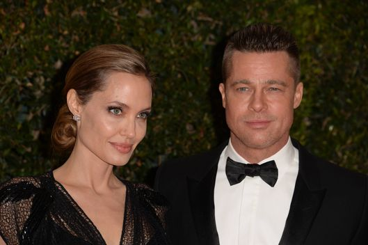 Angelina Jolie and Brad Pitt arrive for the 2013 Governors Awards, presented by the American Academy of Motion Picture Arts and Sciences (AMPAS), at the Grand Ballroom of the Hollywood and Highland Center in Hollywood, California, November 16, 2013.