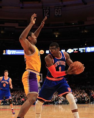 NEW YORK, NY - FEBRUARY 11: Amar'e Stoudemire #1 of the New York Knicks posts up against Ron Artest #15 of the Los Angeles Lakers at Madison Square Garden on February 11, 2011 in New York City. NOTE TO USER: User expressly acknowledges and agrees that, by downloading and/or using this Photograph, User is consenting to the terms and conditions of the Getty Images License Agreement. (Photo by Chris Trotman/Getty Images) *** Local Caption *** Amar'e Stoudemire;Ron Artest