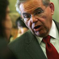 U.S> Sen. Robert Menendez talks with reporters outside the Senate Chamber after voting for the cloture vote on the Tax Compromise bill in the U.S. Capitol December 13, 2010 in Washington, DC. The U.S. Senate held the cloture vote, a key procedural hurdle, on the bill which is a $858 billion tax cut package reached last week by U.S. President Barack Obama and congressional Republicans.