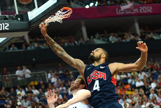 US centre Tyson Chandler jumps for the ball during the London 2012 Olympic Games men's semifinal basketball game between Argentina and the US at the North Greenwich Arena in London on August 10, 2012. AFP PHOTO /TIMOTHY A.  CLARY        (Photo credit should read TIMOTHY A. CLARY/AFP/GettyImages)