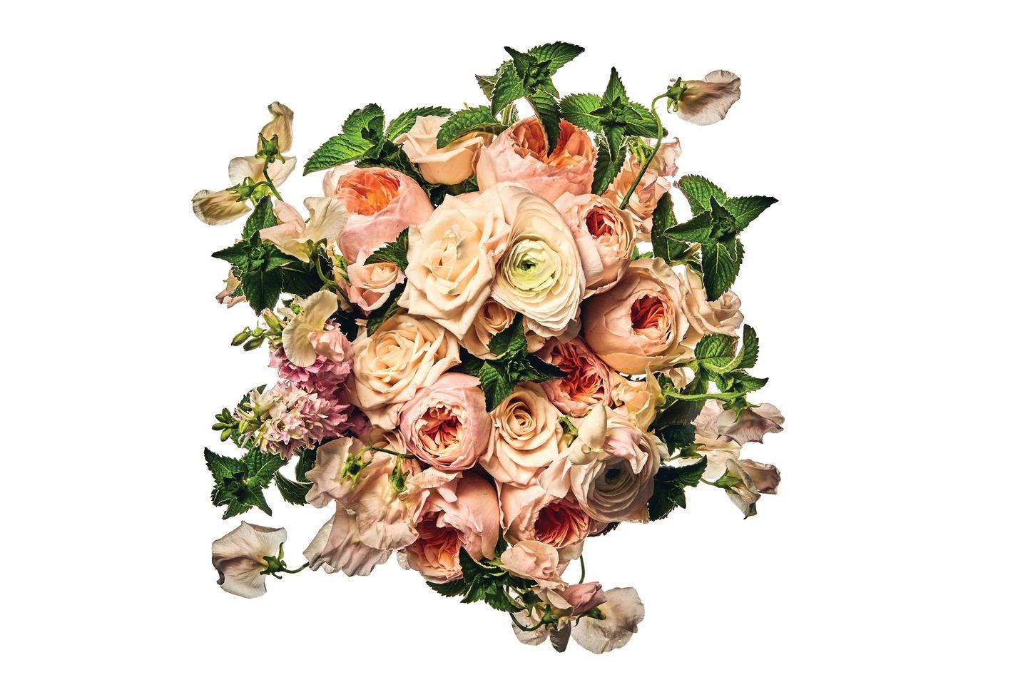 Juliet garden rose, Champagne rose, Clooney Hanoi ranunculus, sweet pea, larkspur, and mint
