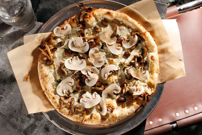 The mushroom pizza is made with fresh and roasted 'shrooms, smoked mozzarella, and ricotta.