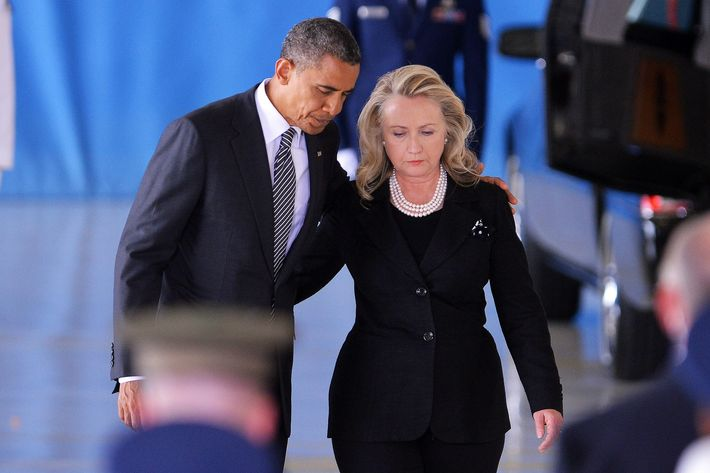 US President Barack Obama and State Secretary Hillary Clinton return to thei seats after speaking during the transfer of remains ceremony marking the return to the US of the remains of the four Americans killed in an attack this week in Benghazi, Libya, at the Andrews Air Force Base in Maryland on September 14, 2012. AFP PHOTO/Jewel Samad (Photo credit should read JEWEL SAMAD/AFP/GettyImages)