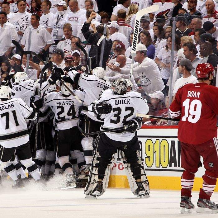 Dustin Penner #25 of the Los Angeles Kings celebrates with teammates Slava Voynov #26, Jeff Carter #77 and Mike Richards #10 after Penner scores the game-winning goal in overtime as the Kings defeat the Phoenix Coyotes 4-3 in Game Five of the Western Conference Final during the 2012 NHL Stanley Cup Playoffs at Jobing.com Arena on May 22, 2012 in Phoenix, Arizona.