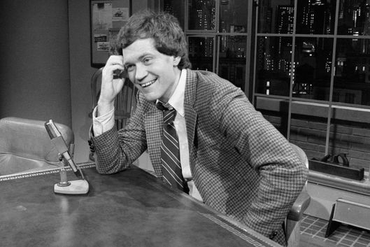 "01 Feb 1982, New York City, New York State, USA --- David Letterman smiles as he hosts the premiere of his talk show on NBC television, ""Late Night With David Letterman""."