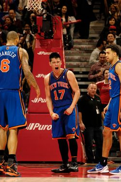 TORONTO, CANADA - FEBRUARY 14:  Jeremy Lin #14 of the New York Knicks (center) reacts after the final buzzer during the defeat of the Toronto Raptors on February 14, 2012 at the Air Canada Centre in Toronto, Ontario, Canada.  NOTE TO USER: User expressly acknowledges and agrees that, by downloading and or using this Photograph, user is consenting to the terms and conditions of the Getty Images License Agreement.  Mandatory Copyright Notice: Copyright 2012 NBAE (Photo by Ron Turenne/NBAE via Getty Images)