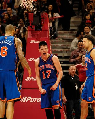 Jeremy Lin #14 of the New York Knicks (center) reacts after the final buzzer during the defeat of the Toronto Raptors on February 14, 2012 at the Air Canada Centre in Toronto, Ontario, Canada.