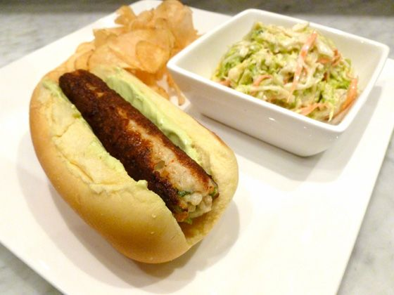 Chef John Taus constructs these dogs from a mixture of fresh caught fish that's minced, seasoned, fashioned into a cylindrical hot dog form, and poached. It's browned and crisped to order, and served on a potato roll with avocado mayonnaise, housemade fingerling chips and cole slaw. <br>