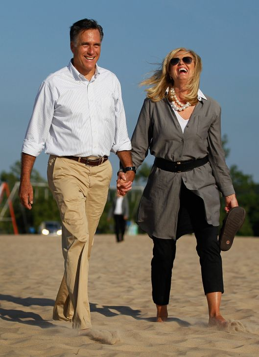 HOLLAND, MI - JUNE 19:  Republican Presidential candidate, former Massachusetts Governor Mitt Romney and his wife, Ann Romney, walk on the beach after the last campaign rally as they complete their five day bus trip in Holland State Park June 19, 2012 in Holland, Michigan. Mr. Romney continues his battle against President Barack Obama for votes.  (Photo by Joe Raedle/Getty Images)