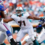 Jonathan Martin #71 of the Miami Dolphins defends along the line against the Buffalo Bills on December 23, 2012 at Sun Life Stadium in Miami Gardens, Florida.