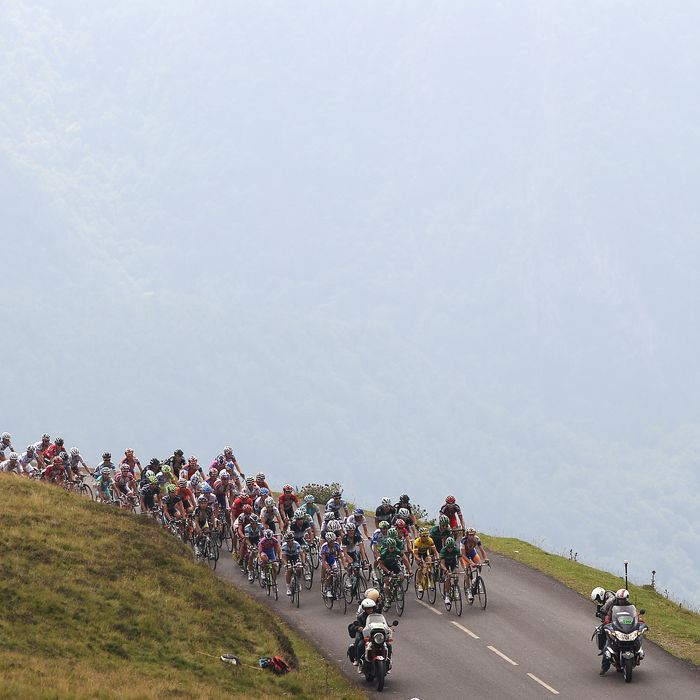 LOURDES, FRANCE - JULY 15: The peloton climbs towards the summit of the Col d'Aubisque during Stage 13 of the 2011 Tour de France from Pau to Lourdes on July 15, 2011 in Lourdes, France. (Photo by Michael Steele/Getty Images)