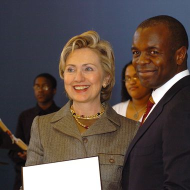 Senator Hillary Rodham Clinton presents the award to Alphonse Fletcher, Jr., President and CEO of Fletcher Asset Management.