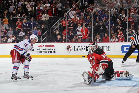 NEWARK, NJ - JANUARY 31: Martin Brodeur #30 of the New Jersey Devils stops a shoot out attempt by Brad Richards #19 of the New York Rangers at the Prudential Center on January 31, 2012 in Newark, New Jersey. The Devils defeated the Rangers 4-3 in the shootout. (Photo by Bruce Bennett/Getty Images)