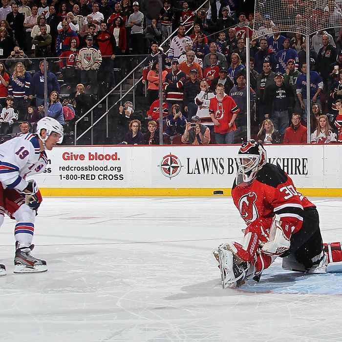 Martin Brodeur #30 of the New Jersey Devils stops a shoot out attempt by Brad Richards #19 of the New York Rangers at the Prudential Center on January 31, 2012 in Newark, New Jersey.