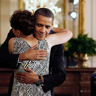 WASHINGTON - JUNE 22: U.S. President Barack Obama (R) embraces Amy Wilhite of Marblehead, Ohio, before speaking during an event to mark the 90-day anniversary of the signing of the Affordable Care Act Act June 22, 2010 in Washington, DC. Immediately after a meeting with Health and Human Services Secretary Kathleen Sebelius, Labor Secretary Hilda Solis, state insurance commissioners, and insurance company CEOs, Obama announced the release of new regulations implementing the patients' bill of rights protections included in the Affordable Care Act. (Photo by Chip Somodevilla/Getty Images) *** Local Caption *** Barack Obama;Amy Wilhite