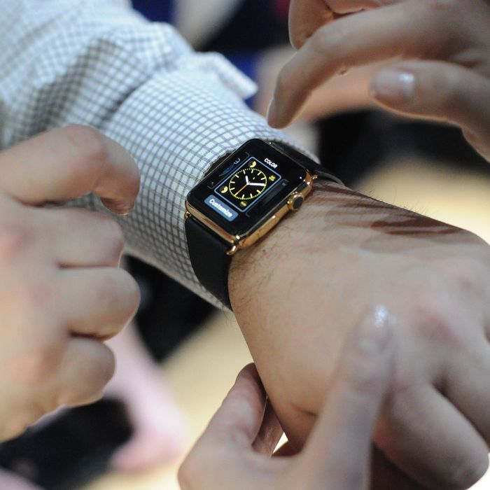 An Apple employee demonstrates how to use an Apple Watch during an Apple media event at the Yerba Buena Center for the Arts in San Francisco, California on March 9, 2015.