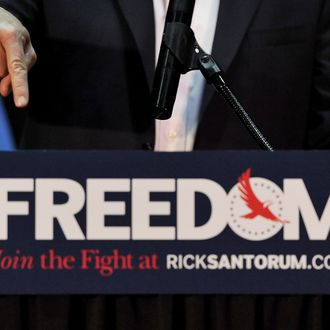 GETTYSBURG, PA - MARCH 20: Republican presidential candidate, former U.S. Sen. Rick Santorum gestures while addressing supporters during an Illinois primary night event at the Gettysburg Hotel on March 20, 2012 in Gettysburg, Pennsylvania. Santorum lost the Illinois primary to Mitt Romney, and plans to travel the next several days in Louisiana, Pennsylvania and Wisconsin. (Photo by Patrick Smith/Getty Images)