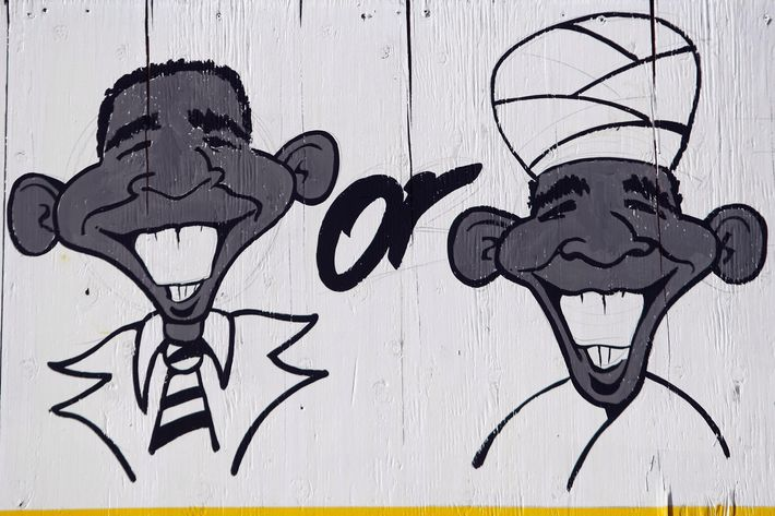 """WHEAT RIDGE, CO - NOVEMBER 21:  A detail of a billboard lampooning President Barack Obama as a Mulsim stands over a used car lot on November 21, 2009 in Wheat Ridge, Colorado. Dealership owner Phil Wolf paid $2,500 to have the sign painted, and it has sparked controversy since it was put up the day before. Wolf, 57, said the dealership received more than a thousand calls from throughout the U.S. and Canada in a single day, both in support and against the sign. """"We've had death threats. We had people call and say they were going to firebomb the place last night,"""" he said, adding that local police provided overnight security outside the dealership because of the threats. Wolf, a supporter of the """"birther"""" movement, questions President Obama's citizenship. """"We've got to recall our country, the election,"""" he said. This guy (Obama), is illegal."""" He also blamed the President for the massacre at Ft. Hood. """"The cavalier attitude taken by Mr. Obama towards the enemy within us is absolutely horrible. If I had a snake in the house, I would kill it,"""" Wolf said. Several left-leaning advocacy groups have called on the public to boycott the auto dealership. (Photo by John Moore/Getty Images)"""