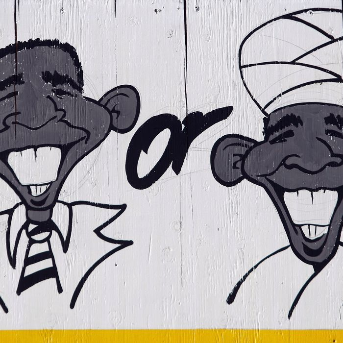 WHEAT RIDGE, CO - NOVEMBER 21: A detail of a billboard lampooning President Barack Obama as a Mulsim stands over a used car lot on November 21, 2009 in Wheat Ridge, Colorado. Dealership owner Phil Wolf paid $2,500 to have the sign painted, and it has sparked controversy since it was put up the day before. Wolf, 57, said the dealership received more than a thousand calls from throughout the U.S. and Canada in a single day, both in support and against the sign.