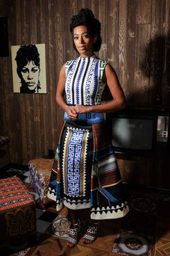 Solange Knowles wearing Mary Katrantzou poses at 'Better Days', an art bar installation by Mickalene Thomas presented by Absolut Art Bureau at Art Basel on June 12, 2013 in Basel, Switzerland.
