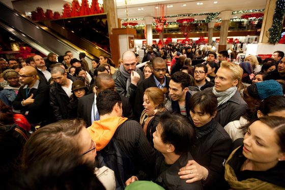 Bargain hunters shop for discounted merchandise at Macy's on 'Black Friday' on November 25, 2011 in New York City.  Marking the start of the holiday shopping season, 'Black Friday' is one of American retailers' busiest days of the year.