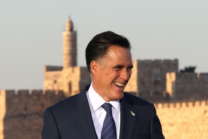 US Repulican party presidential candidate Mitt Romney stands in front of a picture of the Jerusalem Old City walls at an event in Jerusalem on July 29, 2012.  Romney hailed Jerusalem as the capital of Israel, in an apparent endorsement of a position held by the Jewish state but never accepted by the international community.