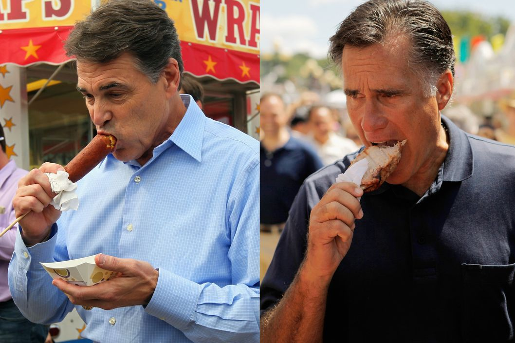 "DES MOINES, IA - AUGUST 15:  Republican presidential candidate and Texas Governor Rick Perry eats a ""veggie"" corn dog while visiting the Iowa State Fair August 15, 2011 in Des Moines, Iowa. An eager salesperson gave Perry the corn dog and didn't tell him it was meatless until after the governor had starting eating it. This is Perry's first trip to Iowa after announcing his run for the GOP presidential nomination.  (Photo by Chip Somodevilla/Getty Images)"